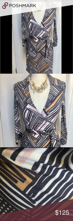 DVF silk wrap dress Beautiful classic DVD wrap dress. Beautiful used condition. No stains or rips gray pink and tan stripes Diane von Furstenberg Dresses