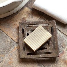 Old drain as soap dish