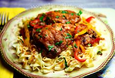 This dish of well-seasoned, braised chicken cooked with peppers, onions, mushrooms, tomatoes, fresh herbs and served over noodles  is a g...