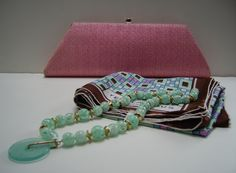 YSL Mint-green lucite long necklace shown with pink Ila handbag, and Ted Lapidus scarf