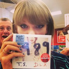 The deluxe #TS1989 is at Target & I just got my copy! 3 voice memos + 3 extra songs, 13 Polaroids. Anddddd hi Dad.