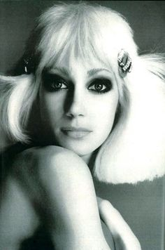 A blonde Marisa Berenson with platinum blonde hair. Photo by Richard Avedon for US Vogue April 1972.