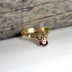 14k gold vertebrae Crown ring with a single 5mm ruby and two 2mm diamonds in natural settings. Band-width is 2.5mm and Crown is approximately 8mm in each direction.All Kria jewelry is handmade ... Precious Metals, Diamonds, Gems, Crown, Band, Natural, Rings, Handmade, Jewelry
