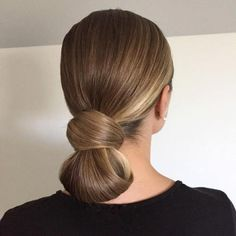 Sleek Low Knot Updo. Tucked under ponytail.