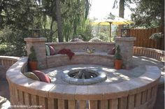 Love the design - low fire pit, surrounded by brick, with a walled enclosure - this looks like it would be very toasty and warm on a cool night.