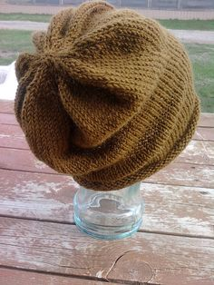 FREE Pattern!  Slouchy hat with interesting detail. It uses less than one ball of Caron's Simply Soft, so I can knit one in about a gazillion colors. For Hubble?
