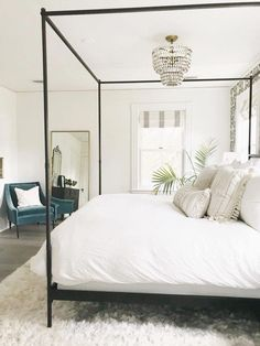 canopy bed with white bedding. White bedroom ideas, all white bedrooms, guest bedrooms that wow, guest bedrooms that make an impression, AirBnb bedroom ideas. how to have a hotel-like bedroom. clean…More How To Create A Modern Bedroom Neutral Bedroom Decor, All White Bedroom, White Bedding, Bedroom Inspo, Home Decor Bedroom, Bedroom Furniture, White Bedrooms, Bedroom Ideas, Bedroom Inspiration