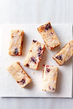 Candied cranberries take center stage alongside macadamia nuts and white chocolate in these lush shortbread bars. Make your own candied cranberries by bubbling them in fruit juice, vanilla beans, cinnamon, and citrus. It's easy! Chocolate Christmas Cookies, Holiday Cookies, Shortbread Cookies, No Bake Cookies, Shortbread Recipes, Baking Cookies, Sugar Cookies, Freezer Cookies, Freezer Food