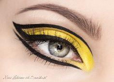 Yellow dramatic eye makeup