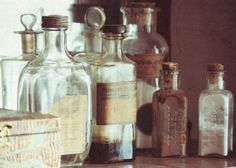 Add a touch of gothic glamour to your table setting by substituting traditional vases with vintage pharmacy bottles. Online vendors, such as Etsy, carry an eclectic assortment of the bottles at fair prices (we love the bottles adorned with French script, see below).