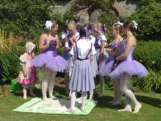 The excitement of the dance! Young dancers prepare to entertain a large group of guests who are gathered to raise money for local charities in the grounds of Cossington Park