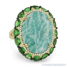 The featured ring is cast in 14k yellow & black gold and showcases oval cut amazonites & green garnets accentuated by round cut diamonds.