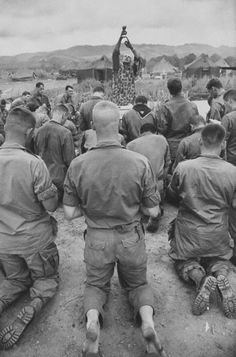Catholic Mass, Vietnam 1966, members of 101st Airborne. The value of the mass. It is sad how often we take it for granted. This picture moved me so deeply; especially seeing the bare feet of the young man in the back. May we never lose sight of the value of the mass.