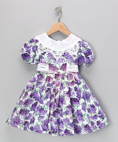 As beautiful as a rose in bloom, this dainty dress is adorned with a rich floral print, lace-filled neckline and billowing skirt that will dance at every step, skip and sashay. An easy-on button back also makes this piece extra special and extra simple.100% cottonMachine wash; tumble dryImported