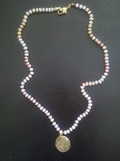 Mom's locket - 14k antique locket on pink opal knotted with coral silk