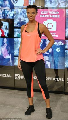 Lucy Mecklenburgh highlights her toned figure in orange top and black leggings as she leads fitness class to promote new sportswear range | Daily Mail Online