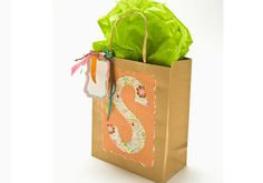 Monogrammed Gift Bag created with Mod Podge. An easy-to-make monogrammed gift bag. #crafts #modpodge #plaidcrafts