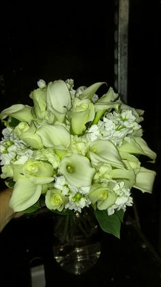 White and pastel calla lilies in this wedding bouquet americasflorist.com