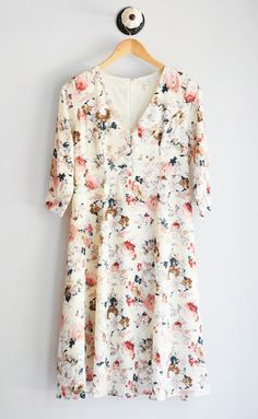 "Beautiful floral midi dress with 3/4 length sleeves and v- neck button up design. Fully lined. Length: small- 41.5, medium- 42"", large- 43"" 100% Polyester Handwash - Line Dry"