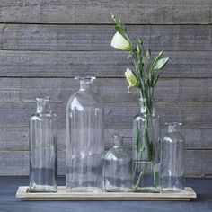 Give your tabletop an instant makeover with this collection of pretty, vintage-inspired glass vases. Sitting on a light, distressed wood tray, the varying heights of these vases keep things interesting...  Find the Glass Vase Tray Set, as seen in the Live the Good Life in Napa Valley Collection at http://dotandbo.com/collections/live-the-good-life-in-napa-valley?utm_source=pinterest&utm_medium=organic&db_sku=89756