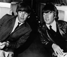 George Harrison, left, and John Lennon aboard an airplane in Los Angeles before leaving for London on May 25, 1964.
