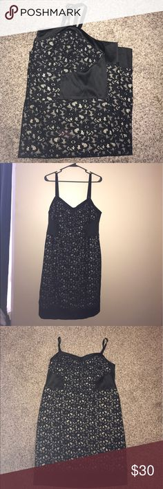 """Torrid Cocktail Dress Worn once, perfect condition except for missing the belt that went with it. Not noticeable the belt loops are tightly tucked and looks great without a belt. Bust measurement is 19"""". Length top to hem is 30"""". Waist under bust measures 19.5"""". Hips measures approximately 21"""" with a little room to stretch. Adjustable straps. Great black and cream contrast lace. Zipper on back. torrid Dresses Mini"""