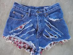 Hand upcycled jeans shorts by 16-year old designer, Sophia Scanlan  High waisted, both sides ripped.