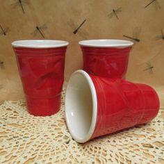 Red crinkled plastic ceramic cup by haldecraft on Etsy, $24.00