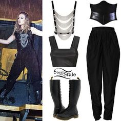 """Little Mix debuted their new music video for """"Salute"""" last Thursday. In one shot, Perrie wore  the AQ/AQ Manic Leather Cropped Bodice (£65.00), a Nikita Karizma Underbust Corset (£205.00), American Apparel Party Pants ($51.00), the Tribal Leather Body Jewellery by Maria Francesca Pepe ($503.00) and a pair of Dr. Martens 1B60 Boots ($160.00)."""