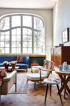 Large, open windows in a colorful mid century home.