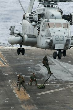 Marines fast-rope from a helicopter. by Official U.S. #Navy Imager