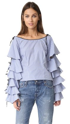 ¡Cómpralo ya!. Caroline Constas Amelia Ruffle Top - Blue Gingham. Voluminous ruffles embellish the long sleeves of this shoulder baring Caroline Constas top. Adjustable shoulder ties. Hidden back zip. Fabric: Poplin. 100% cotton. Dry clean. Made in the USA. Measurements Length: 24.5in / 62cm, from shoulder Measurements from size S. Available sizes: XS , tophombrosdescubiertos, sinhombros, offshoulders, offtheshoulder, coldshoulder, off-the-shouldertop, schulterfreiestop…