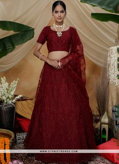 We are to breathe life into your aspirations and to make a mark in the world of style. An outstanding maroon net a line lehenga choli will make you look very stylish and graceful. This attire is beautifully adorned with embroidered and thread work. Comes with matching choli and dupatta. (Slight variation in color, fabric & work is possible. Model images are only representative.) Bollywood Bridal, Bollywood Lehenga, Lehenga Choli Online, Bridal Lehenga Choli, Silk Lehenga, Indian Wedding Lehenga, Saree Wedding, Stone Work Blouse, Choli Dress