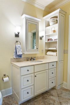 Tall shelving over vanity uses vertical space and frees up space on the vanity counter