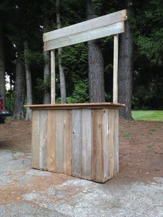 Rustic lemonade stand made from reclaimed lumber.