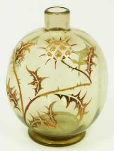 Émile Gallé | Emile Galle 'Chardons' art glass vase having and enameled design depicting flowers with leaves on branches over smokey clear glass.