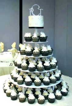 Cupcakes are now the thing and many brides are choosing to have cupcake wedding cakes instead of the traditional tiered wedding cake. I completelyy understand why, less mess, easier to serve and m… Small Wedding Cakes, Wedding Cakes With Cupcakes, Elegant Wedding Cakes, Elegant Cakes, Beautiful Wedding Cakes, Cupcake Wedding, Beautiful Cakes, Cupcake Tree, Cupcake Cakes