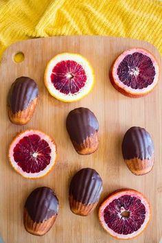 Chocolate Dipped Blood Orange Madeleines - Lito Supply Co. Macarons, Tea Cakes, Dark Chocolate Chips, Chocolate Dipped, Cupcakes, Biscotti, Madeleine Recipe, Cookie Recipes, Dessert Recipes