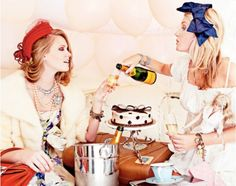 Throw a ladies night party with vintage hats and champagne.