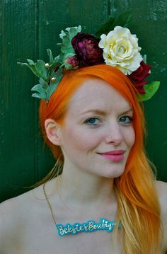 This links to the headpiece for sale, but I just find the image strikingly beautiful. Orange ombre hair, bright green eyes, and a crown of flowers.