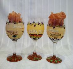 """take our hand-painted napa valley themed wine glasses along on your winery tours. they are just the right size for """"sampling."""" glassware features winery names and logo and can be designed in whatever color palette you prefer and can personalized. great for a girl's getaway weekend.  $28 per piece  $25 per piece for set of two or more"""