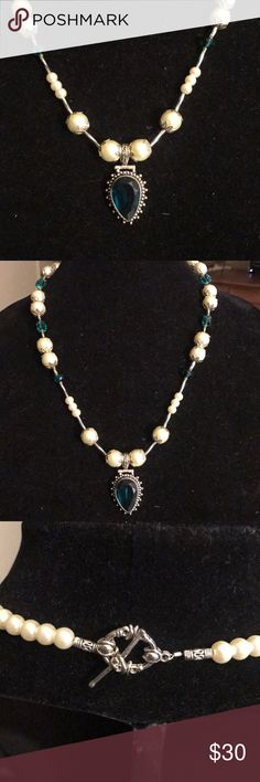 """🛍🎉stunning faux pearl and crystal necklace Beautiful faux pearl and crystal necklace with Gemstone pendant. Greenish blue color. Absolutely gorgeous. Measures 22 1/2"""". Designed and crafted in my home studio. One of a kind. I believe each piece of jewelry be as unique as the woman wearing it. Will arrive in an organza pouch. Please check out my closet for more one of a kind handcrafted jewelry. All jewelry purchases come with free earrings. Bundle two or more items and save! Jewelry…"""