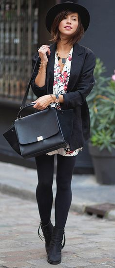 Zoé Alalouch is wearing a black blazer from Mango, vintage floral dress, bag from Celine and the boots are from Acne