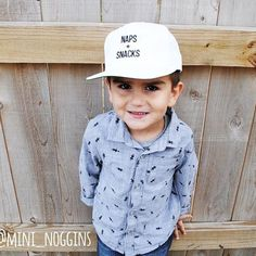 ➕How handsome is this kid?! Mini model Parker is rockin' one of our flat bill snapbacks.  Who doesn't love naps + snacks? [[ The snapbacks fit most minis ages 2 - 6. It has an adjustable back to fit as your mini grows.  We will be offering this style hat in  colors and several designs! Parker is 4 yrs old. ]] ➕ • • • #mininoggins #snapbacks #embroideredhats #embroidery #whitehat #coolkid #stylishkids #momlife #mommylife #handsomeboy #shopsmall #wishthaticouldbelikethecoolkids #napsandsna...