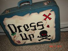 Thrift store boy dress up clothes suitcase - A fun way to keep dress up clothes. We also need more play clothes - thrift store finds especially after Halloween.
