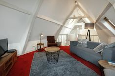 The comfortable living room of Stayci Apartment Royal Loft in The Hague.