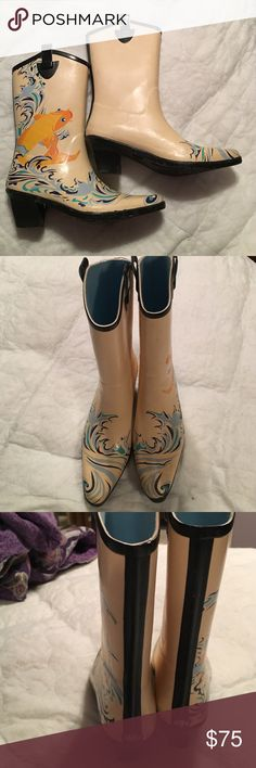 dav cowboy style rain boots dav brand cowboy boot style rain boots. They have the koi fish on the outside of both boots with a light yellow background with a light blue knit interior. Worn only 2-3 times. In excellent condition. Look fabulous with skinny or straight leg jeans or cute skirts on rainy days. dav Shoes Winter & Rain Boots