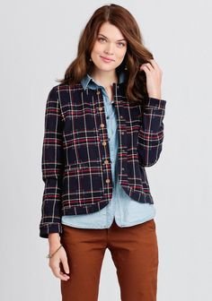 Crafted in a deep navy hue, this darling jacket features a geometric-inspired plaid pattern in blue, red and, cream. Finished with a quilted motif and brass-toned snap button closures, this chic ...