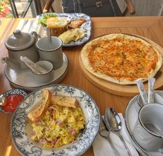 Breakfast with Bacon carbonara, cheese pizza and kampung fried rice