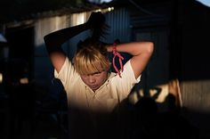A girl puts her hair in a pony tail as she gets ready to walk to school from a squatter camp in Krugersdorp on March (REUTERS/Finbarr O'Reilly) # Walk To School, Picture Editor, Big Picture, Congo, Her Hair, Ponytail, Squats, Photo Art, South Africa